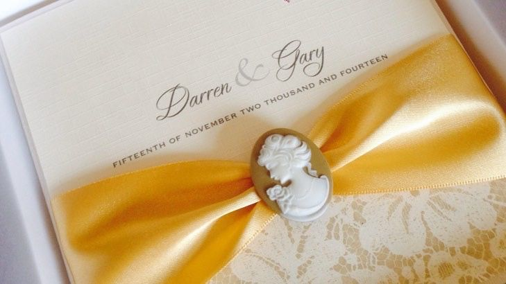 Cameo invitation with gold ribbon and ivory card