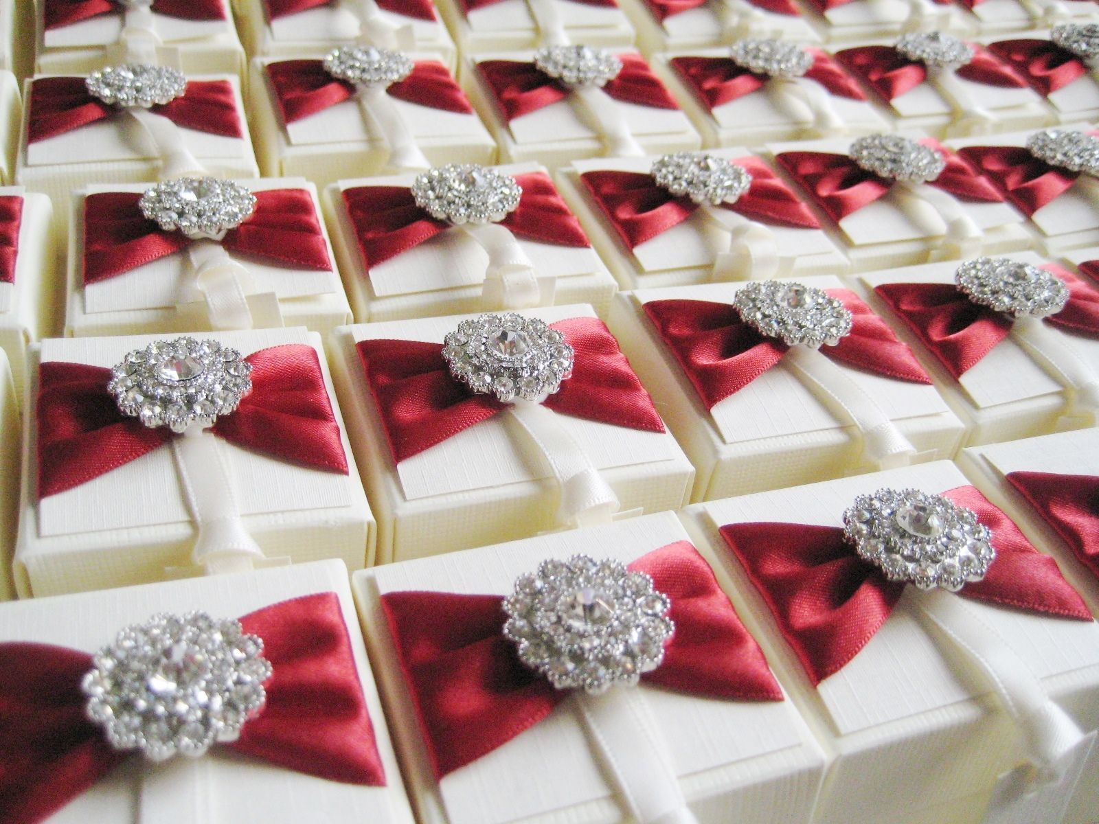 Wedding favour boxes decorated with vintage crystal and ribbon