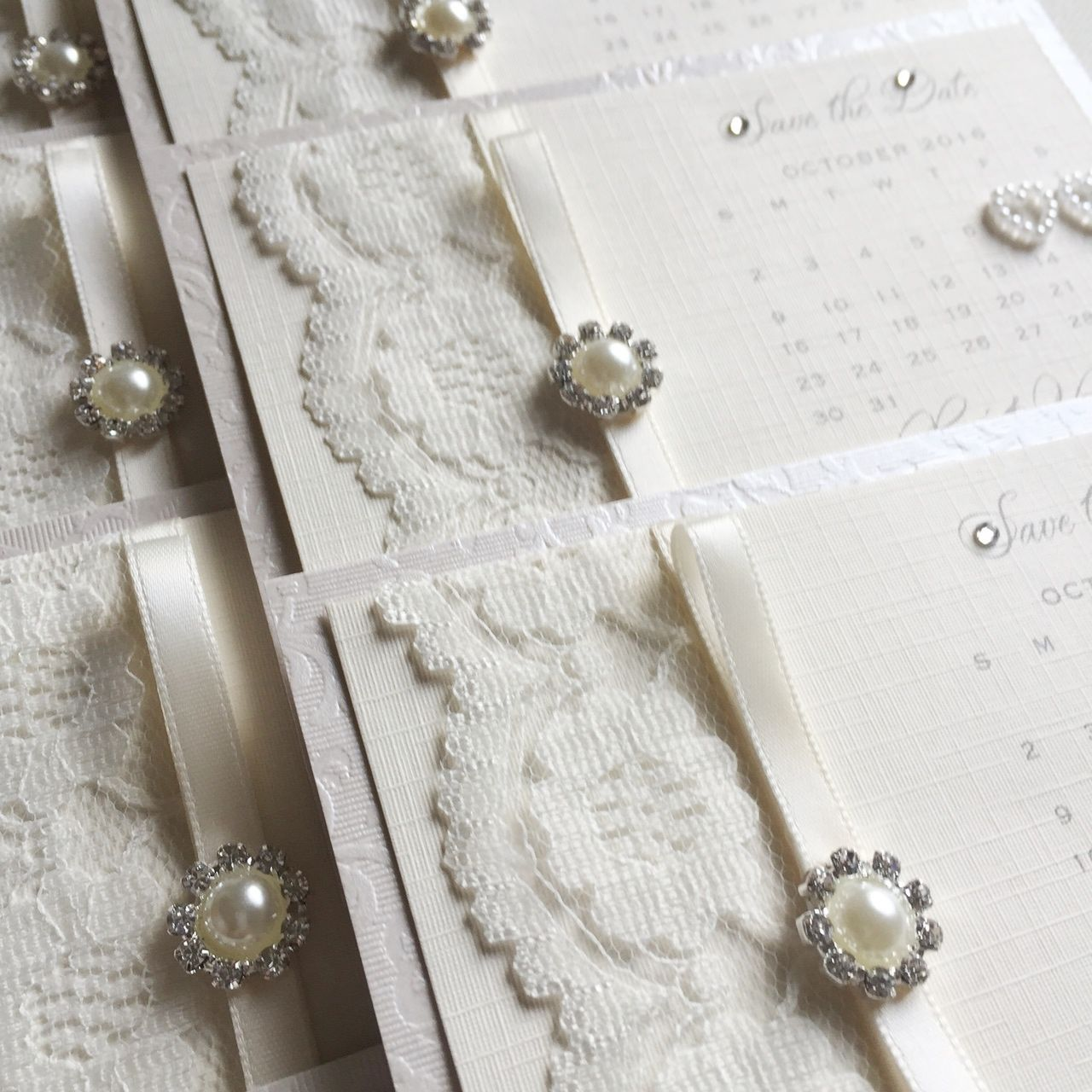 Lace save the date card with pearl crystal