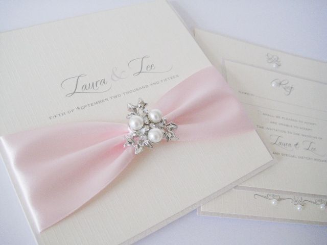 Pearl invitations with pink ribbon