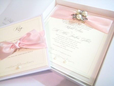Flat postcard style boxed wedding invitation with blush pink ribbon and brooch.