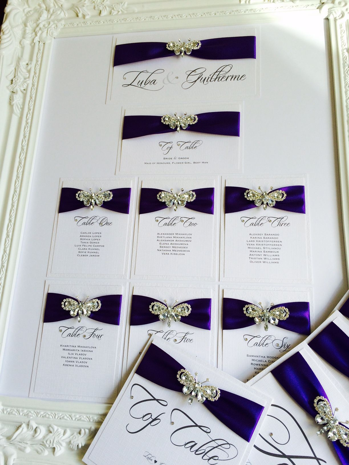 butterfly seating plan with purple ribbon