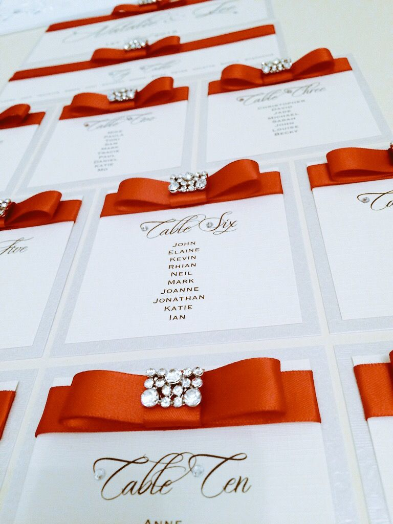 Framed seating plan with diamante brooch and red dior bow