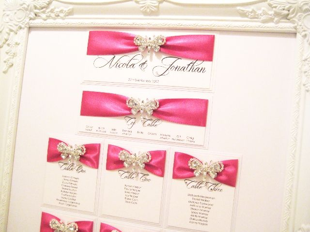 Hot pink butterfly seating plan in ornate frame