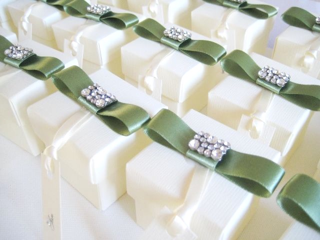 Ivory favour boxes with crystal brooch and ribbon
