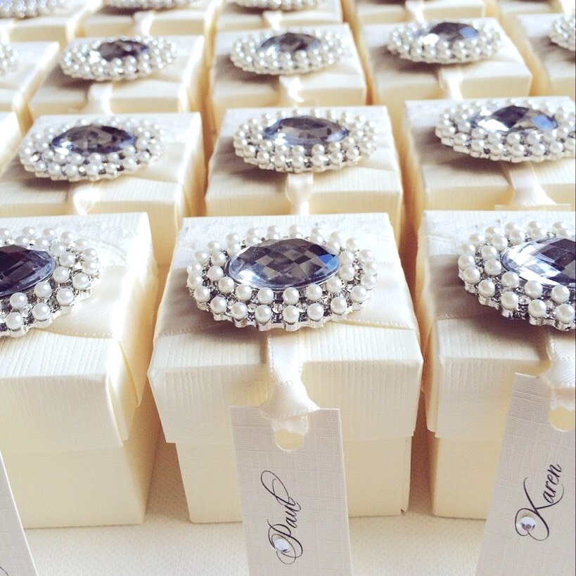 Luxury ivory favour boxes with name tag and Crystal pearl brooch