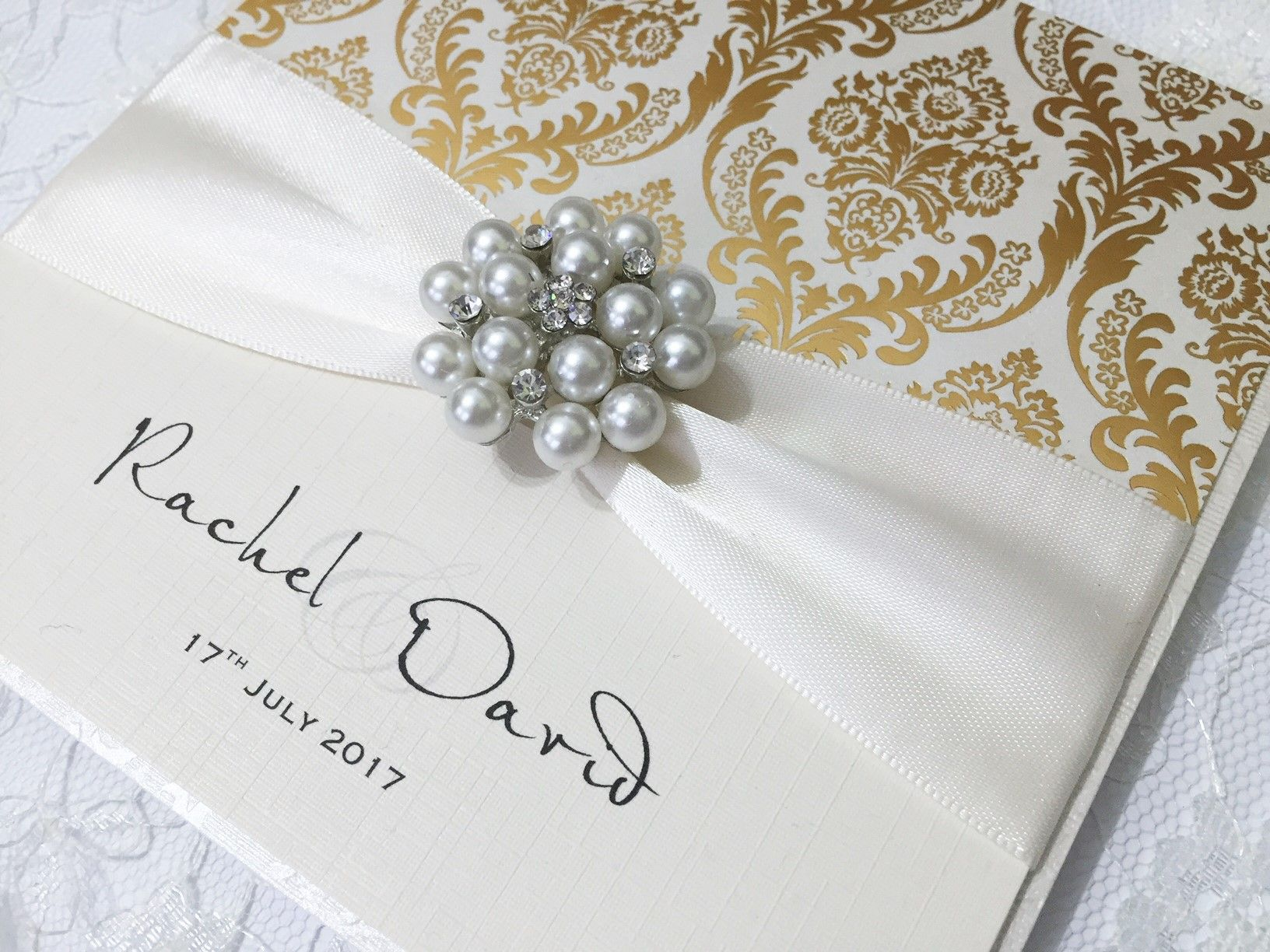 Gold and Ivory wedding invitations with beautiful pearl brooch in boxes