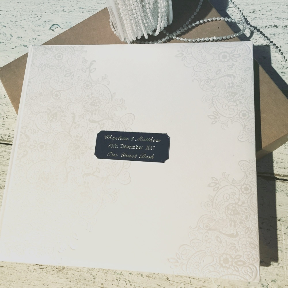 Personalised guest book in white embossed with names