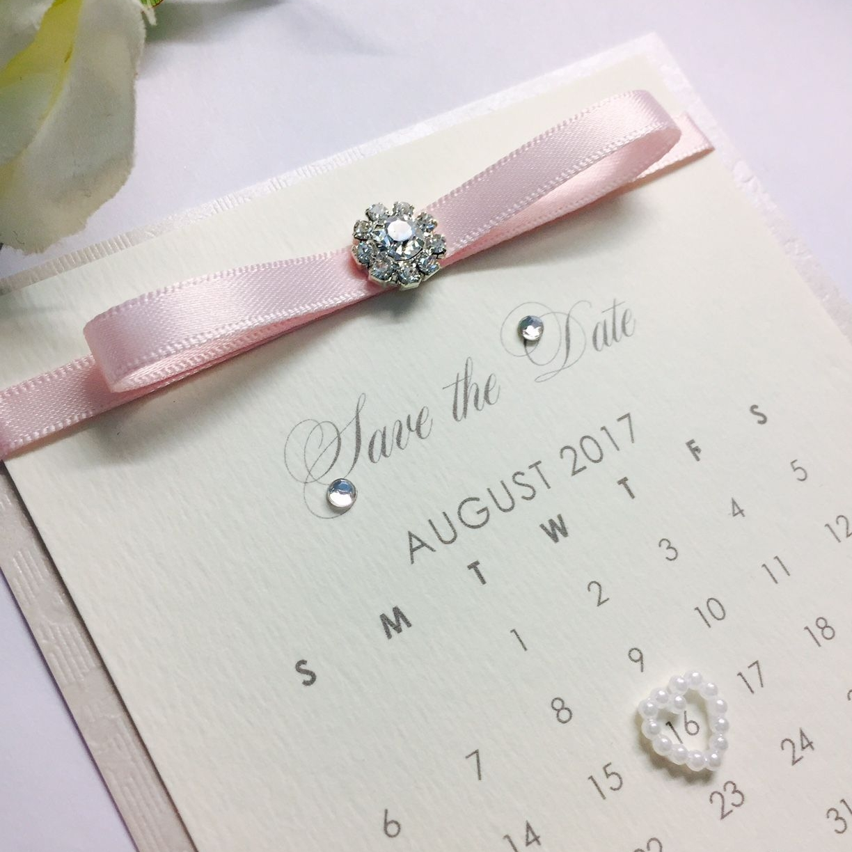 Pink save the date wedding calendar with diamante and light pink ribbon