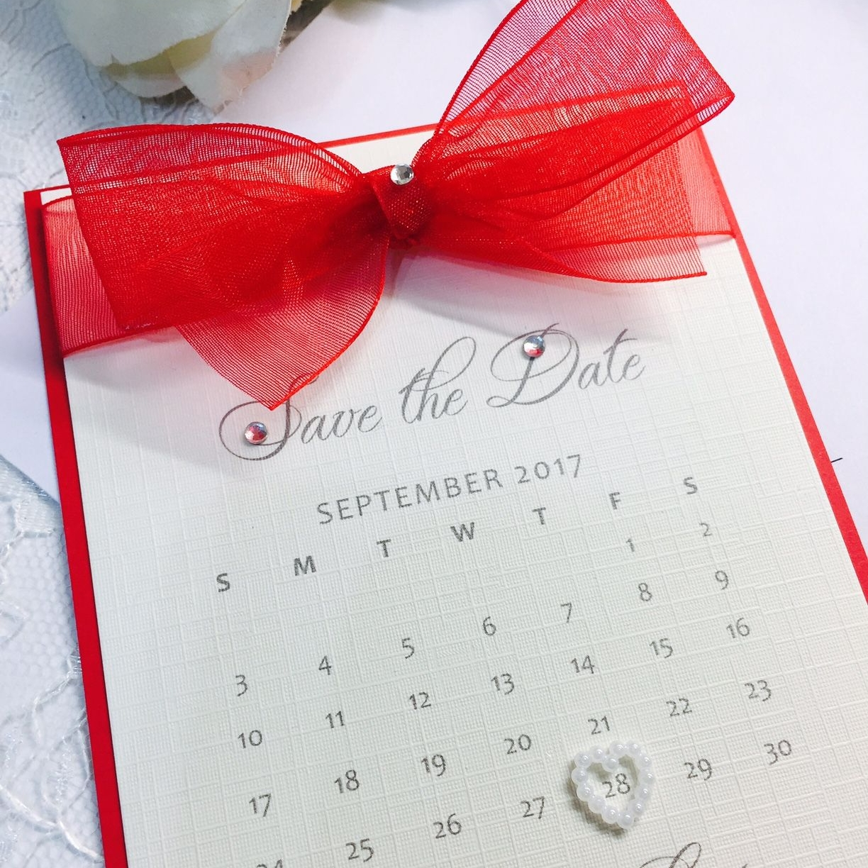 save the date card with red organza ribbon