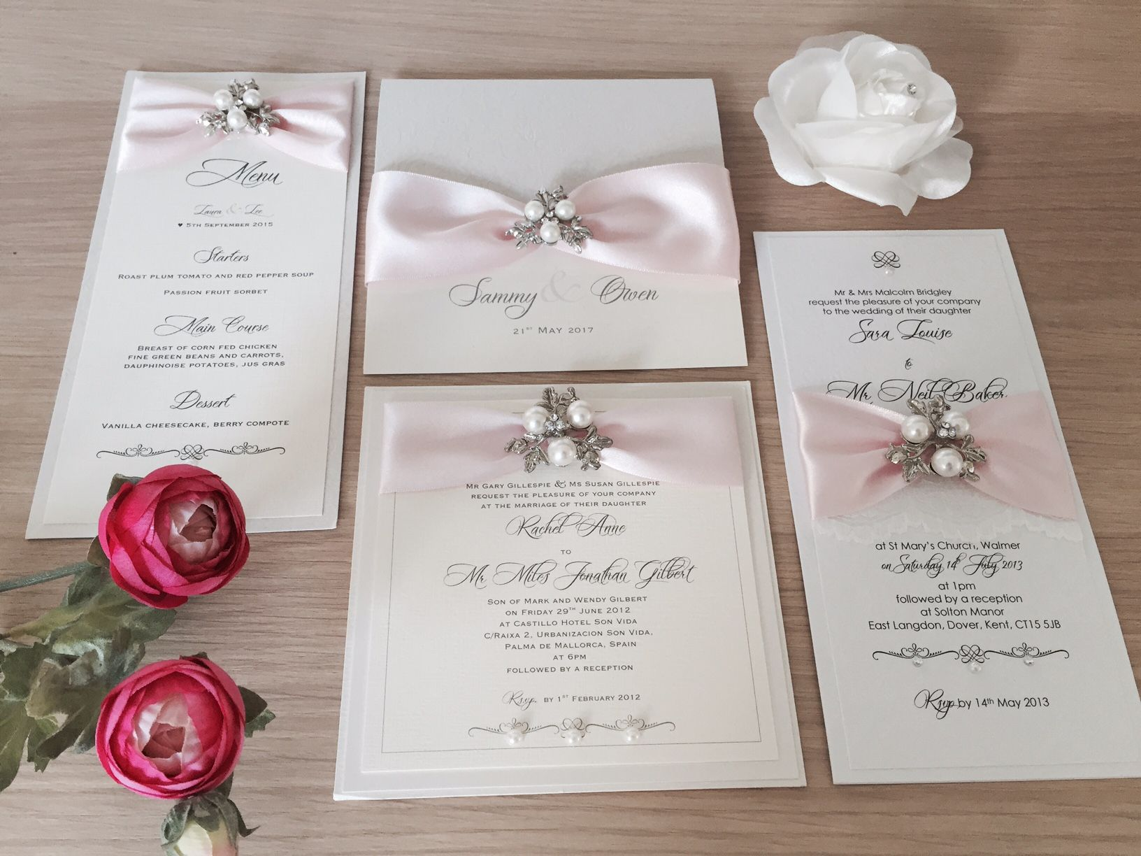 Elegant wedding invitations with pearl brooch