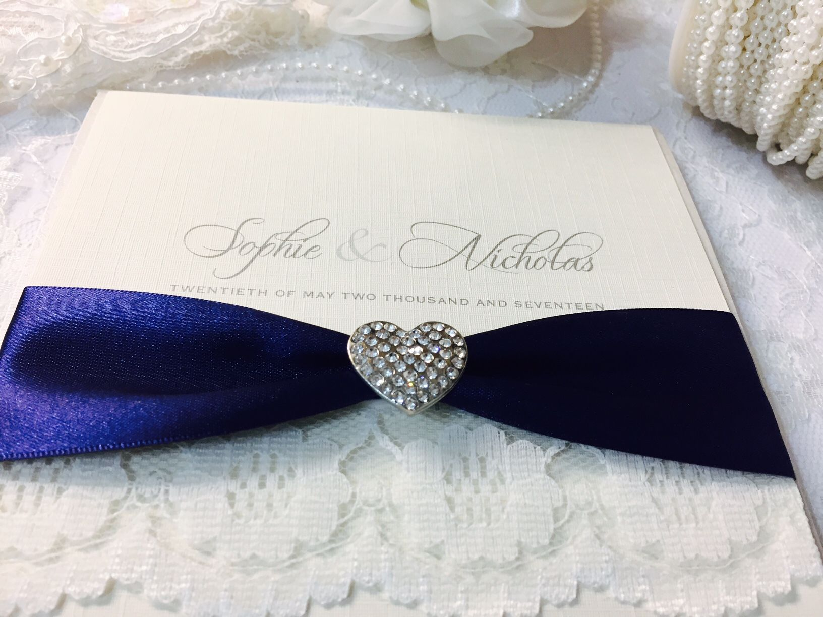 Wedding invitations with diamante hearts