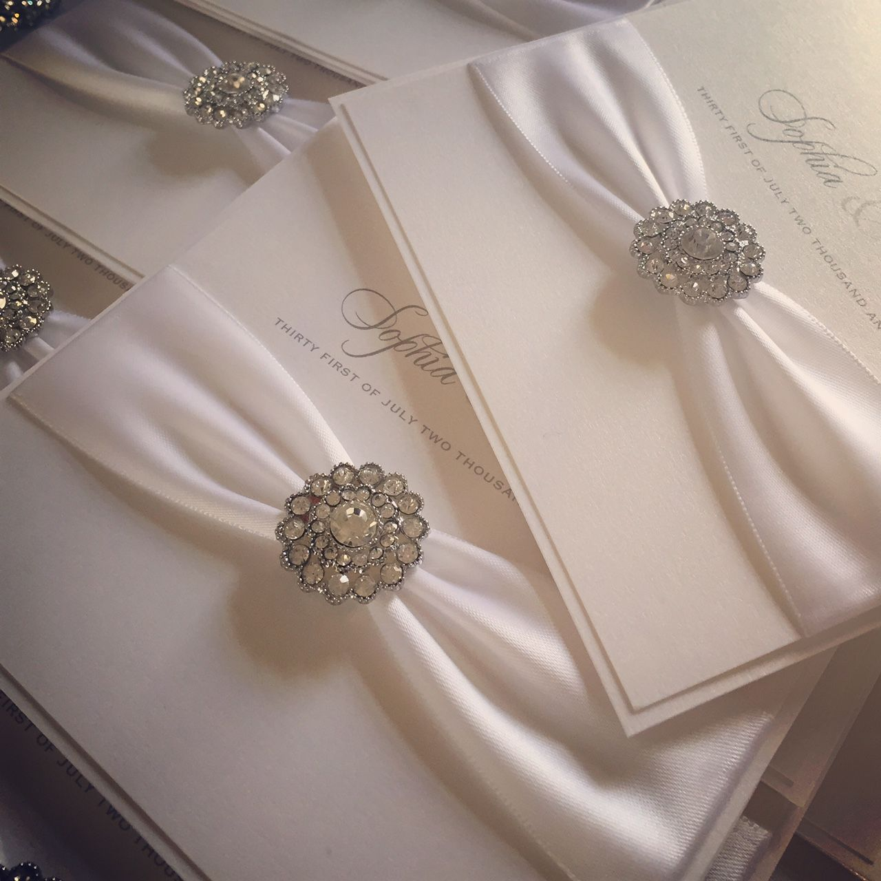 Pearlescent wedding invitations with white ribbon
