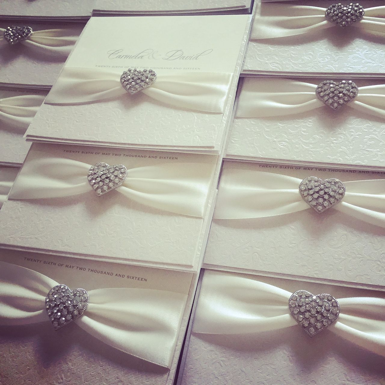 Elegant invitations with vintage heart brooches