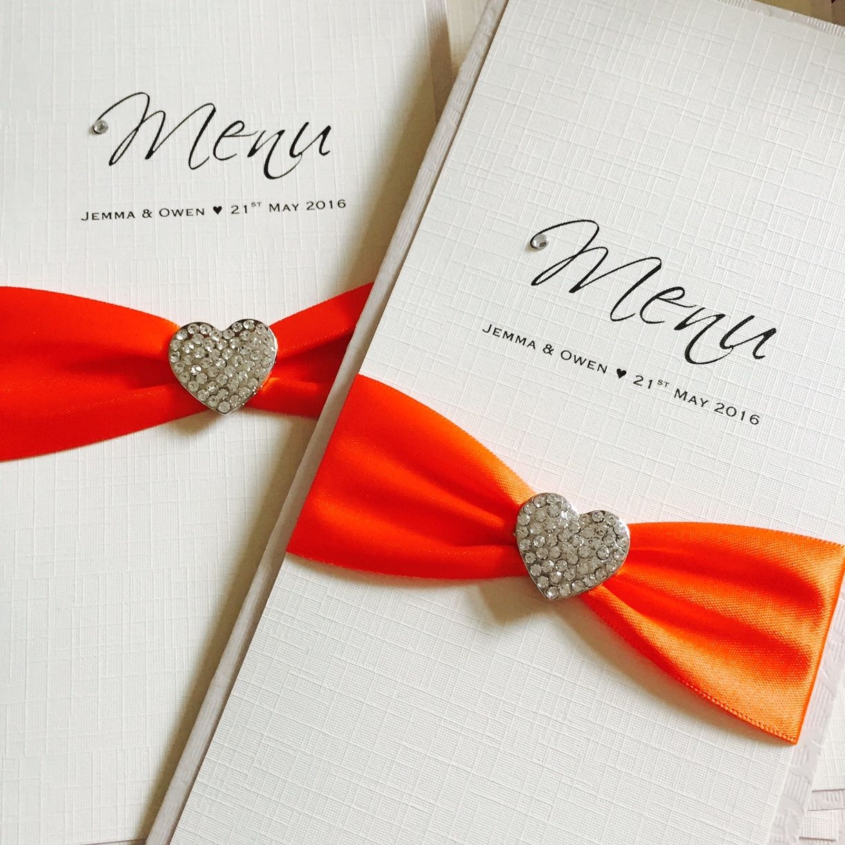 Luxury wedding breakfast menus with diamante heart