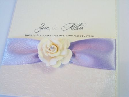 Ivory and lilac invitation with crystal rose