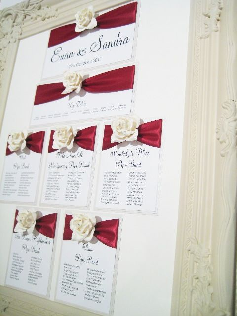 rose seating plan with burgundy ribbon