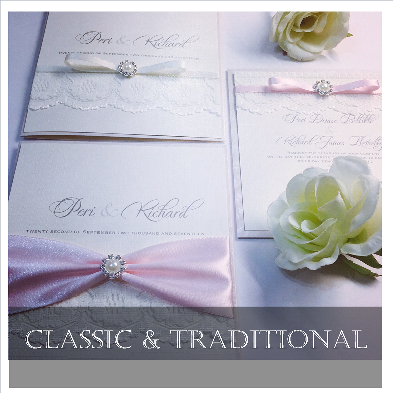 Traditional style wedding invitations decorated with ribbons and embellishments