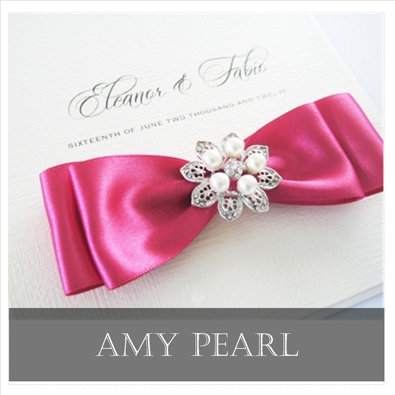 Elegant wedding invitation with pretty bow and pearl brooch