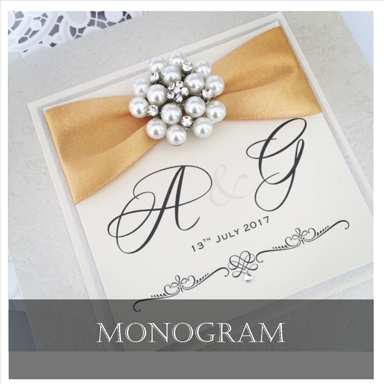 Stylish Monogram invitations with fancy brooches