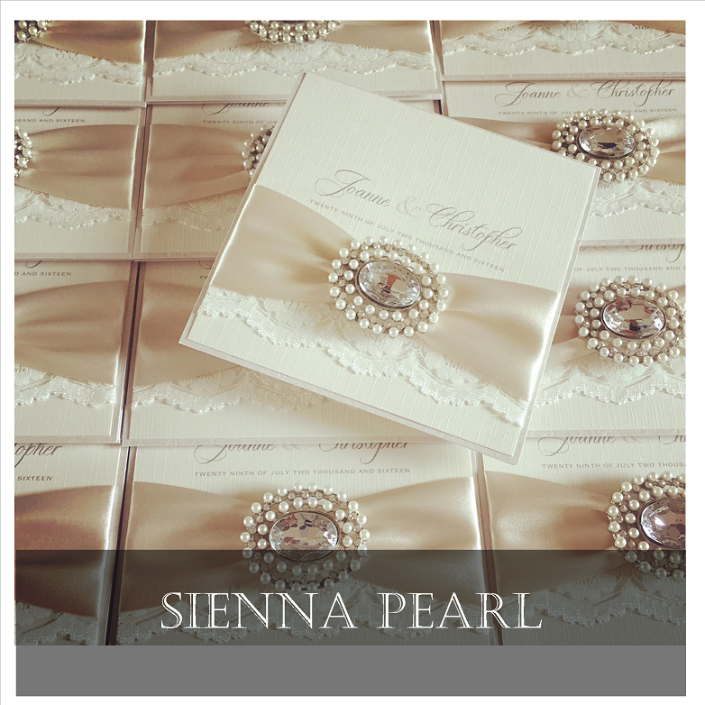luxurious lace invitations with pearl brooch