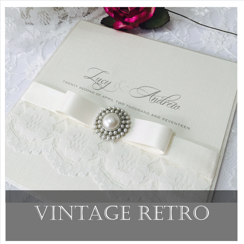 Vintage retro style invitations with pretty lace and brooch