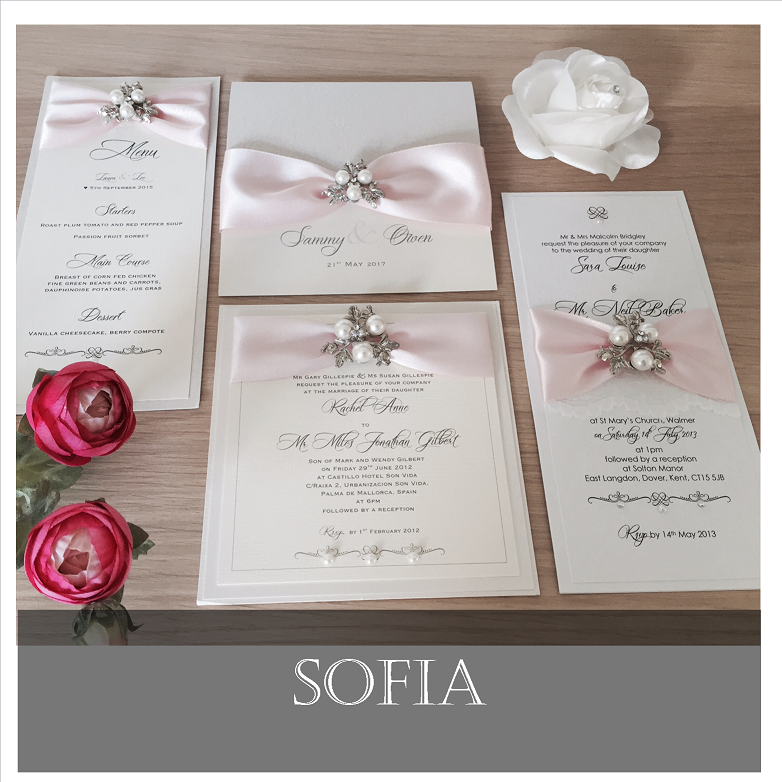 Pink wedding invitation with pearl brooch