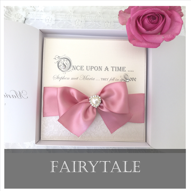 Fairytale luxury wedding invitations with pink ribbons and heart brooch