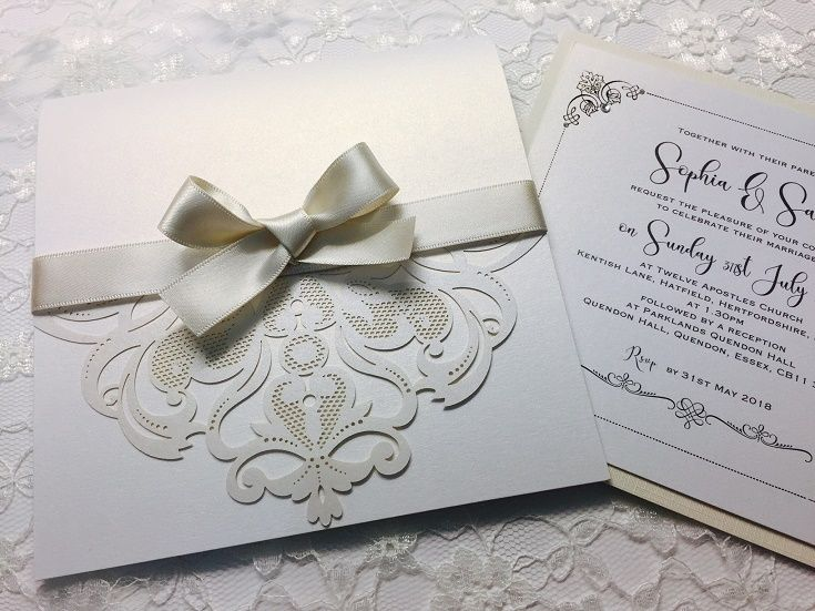 Laser cut invitation with pearlescent card and champagne ivory ribbon