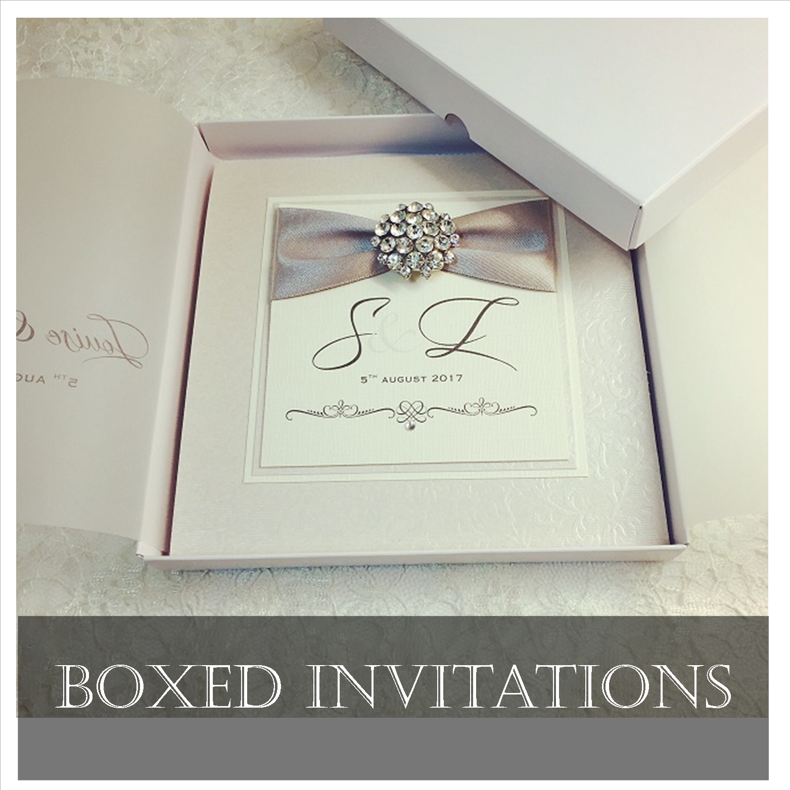 Luxury boxed wedding invitations with elegant brooches