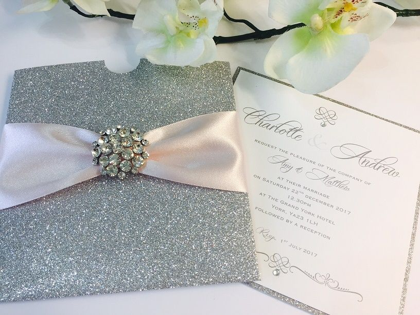 Glitter boxed wedding invitation with pale pink ribbon and diamante brooch