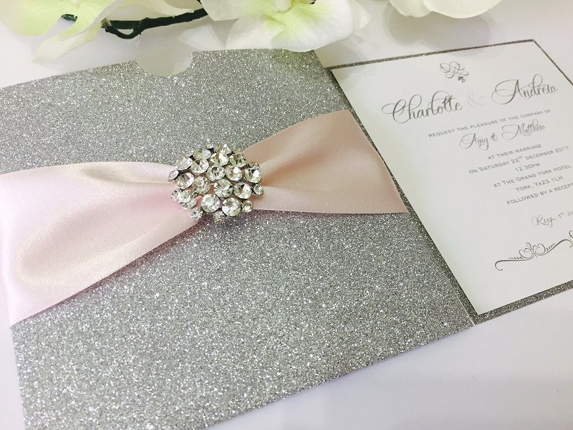 Sparkly glitter pocket style invitation with diamante brooch