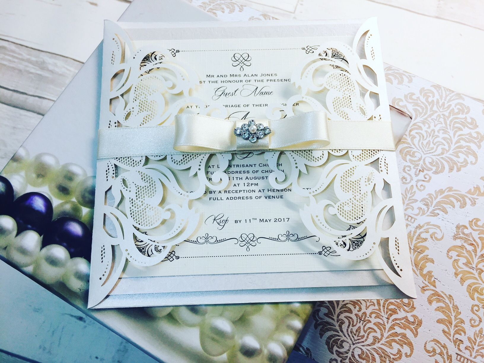 Luxury boxed wedding invitations handmade with elegant brooches and ribbons
