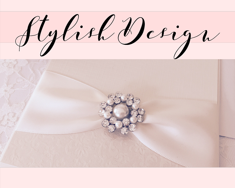 Luxury ivory wedding invitations with ribbons and brooches
