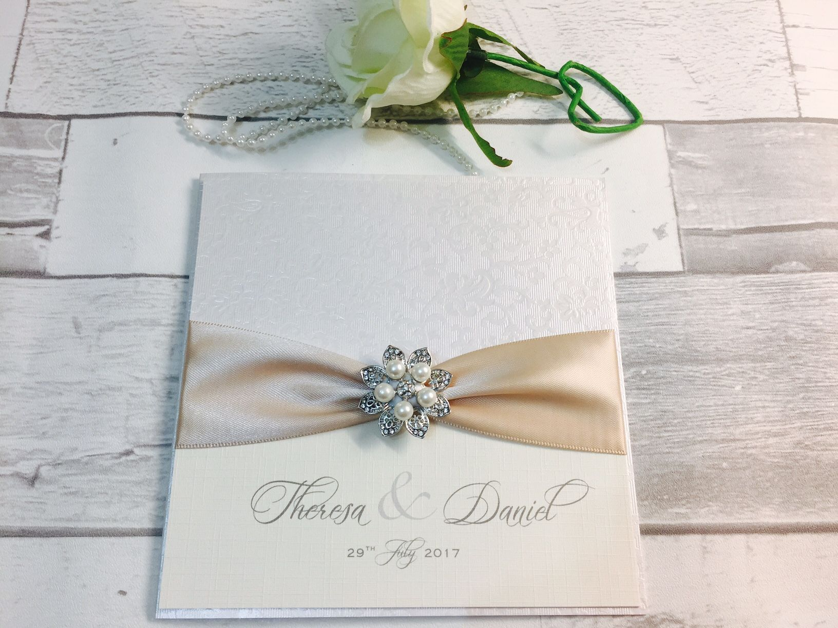 Pretty wedding invitations with brooches and ribbons amor designs amy pearl stopboris Gallery