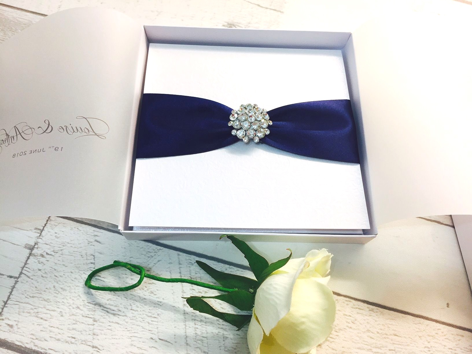 Boxed crystal wedding invitations with beautiful diamante brooch