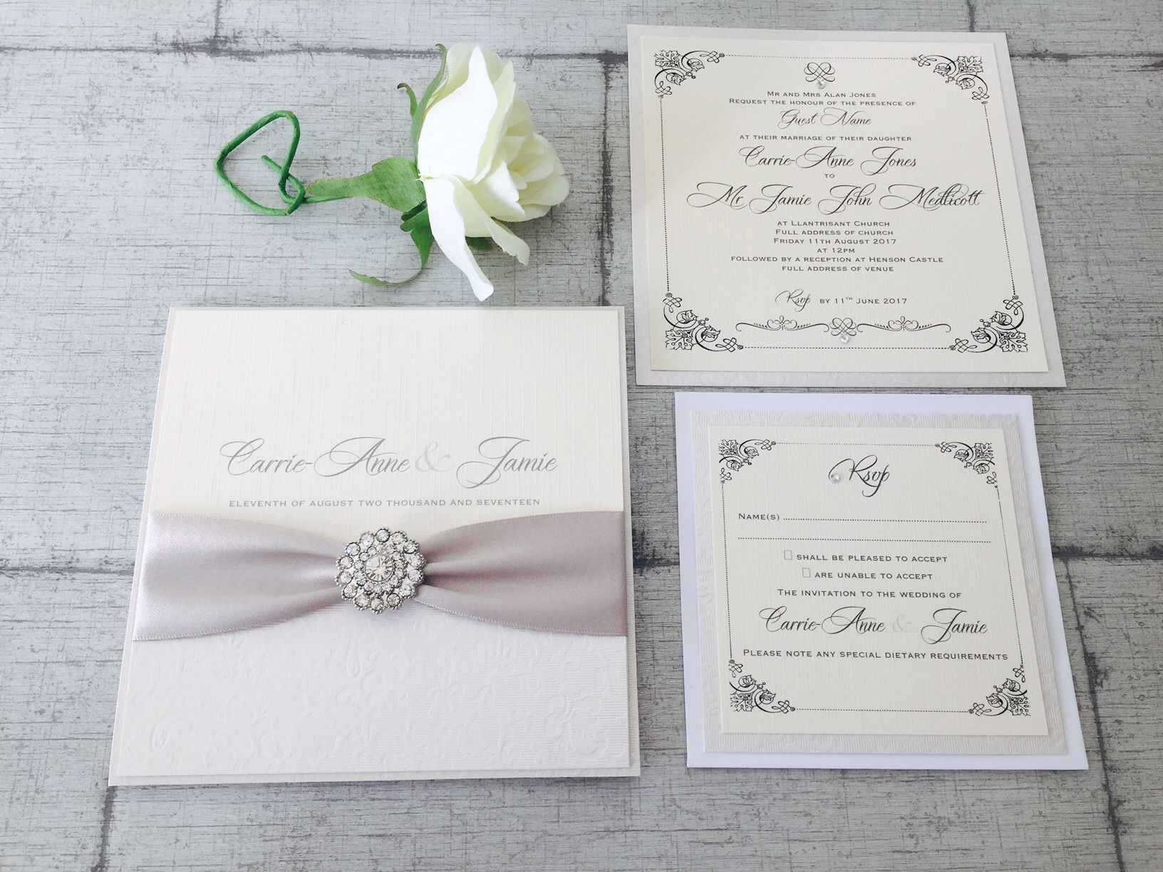Romantic luxury wedding invitations with sparkly brooch in silver and ivory