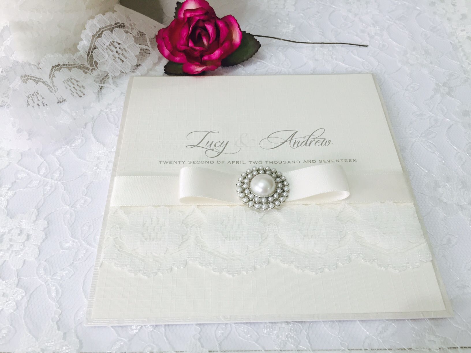 Lace wedding invitation with dior ribbon and pearl brooch