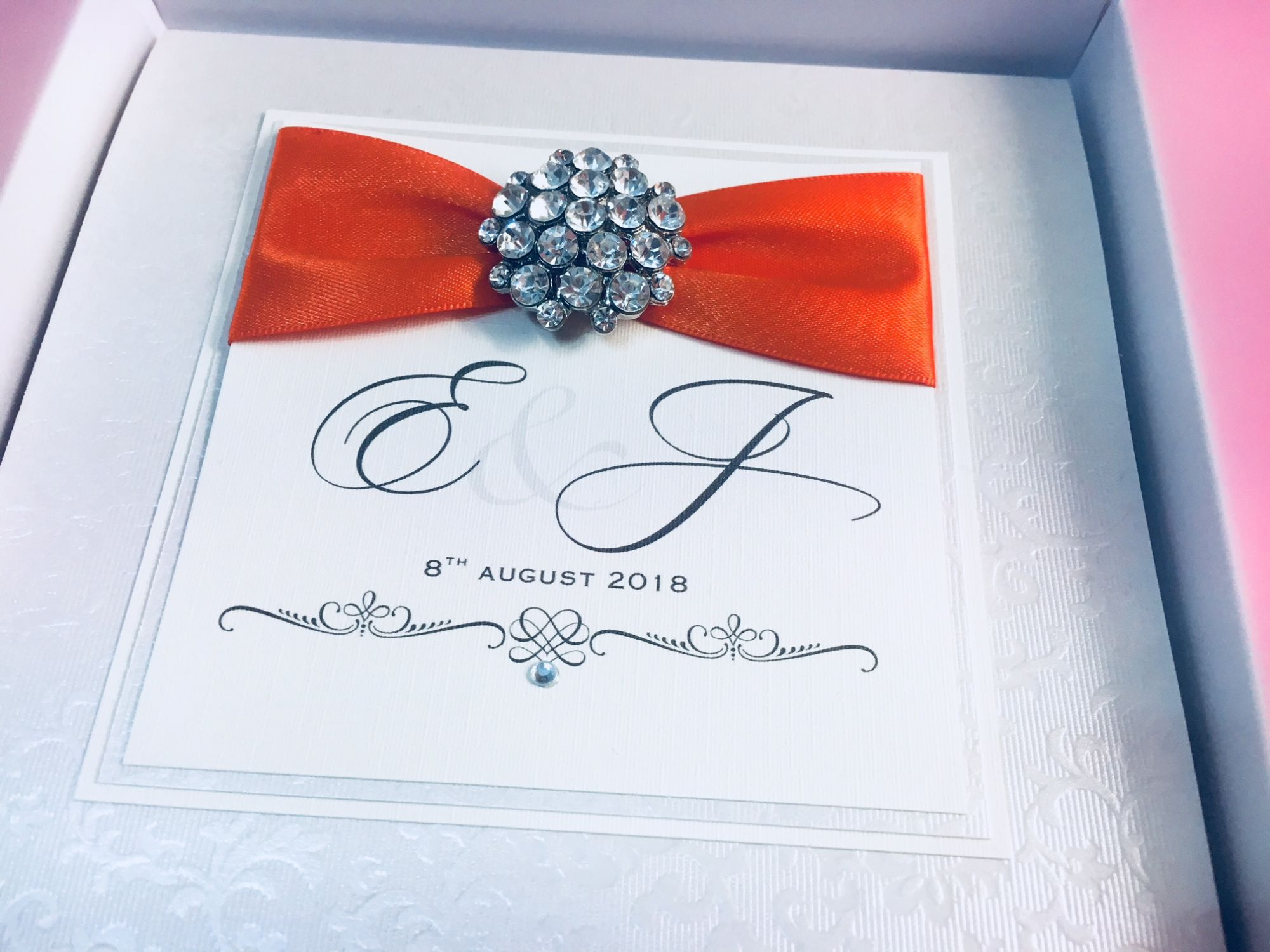 Monogram wedding invitations with beautiful brooch
