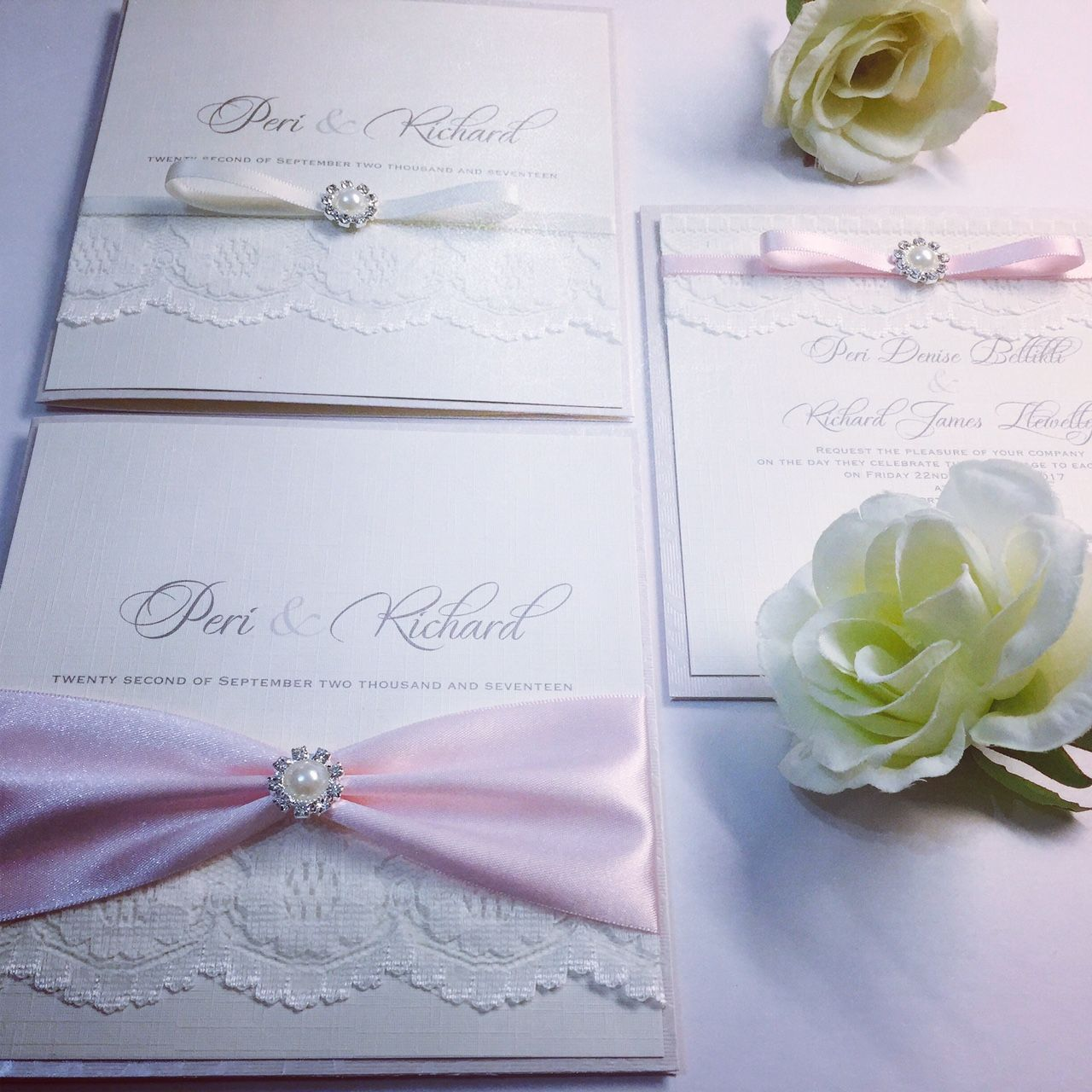 Elegant pearl wedding invitations with small brooch pearls