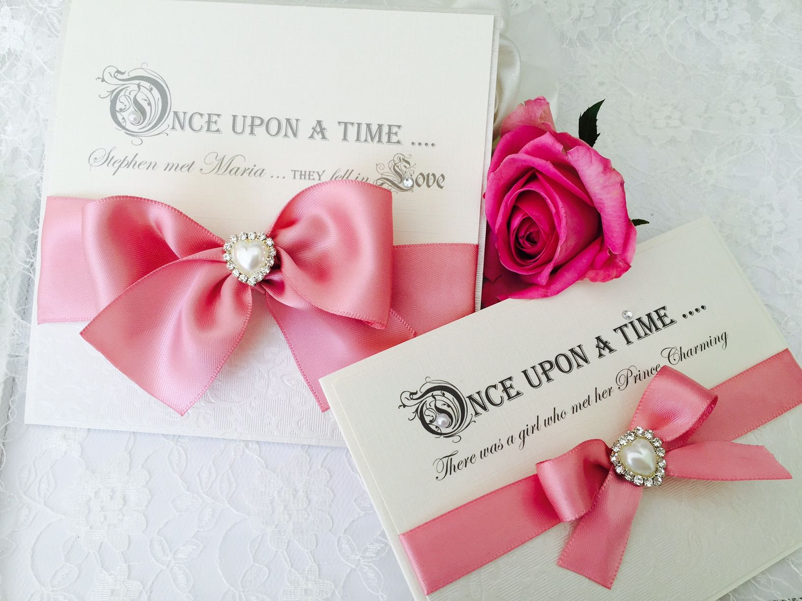 Fairytal quotes wedding invitations with bows and heart brooches