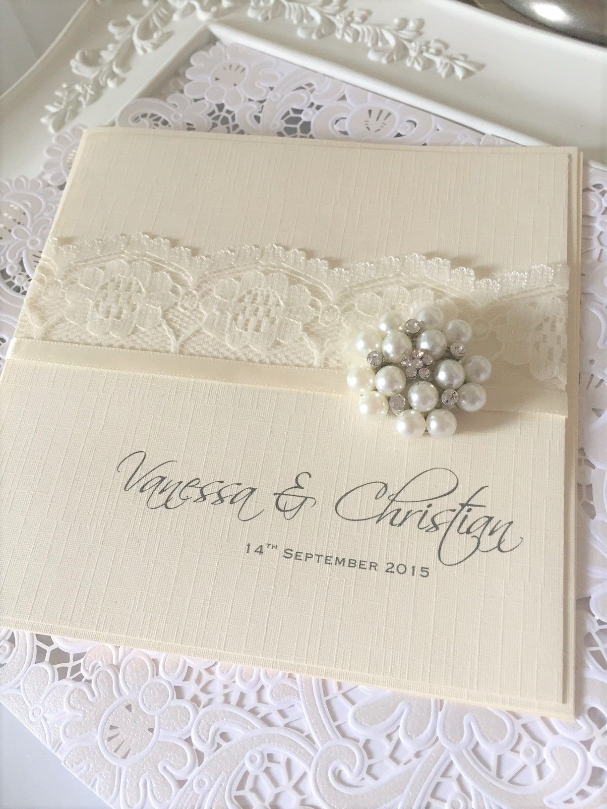 boxed invitation with beautiful pearl brooch
