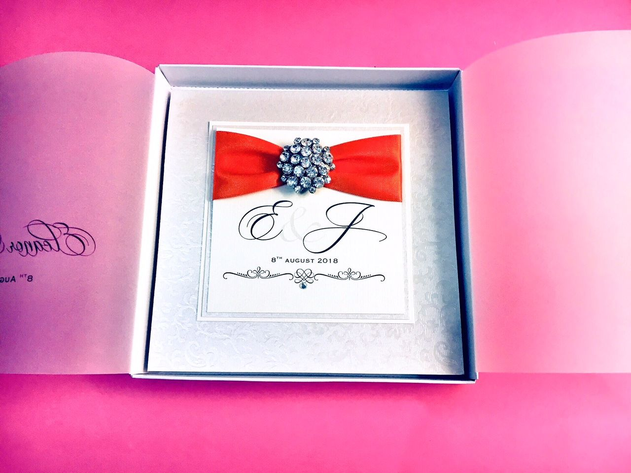 monogram diamante boxed wedding invitation with orange ribbon