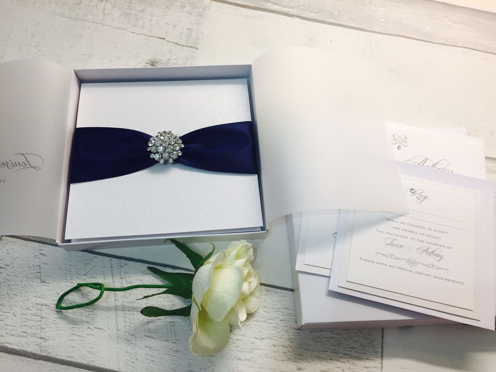 Luxury boxed wedding invitation with luxury crystal brooch