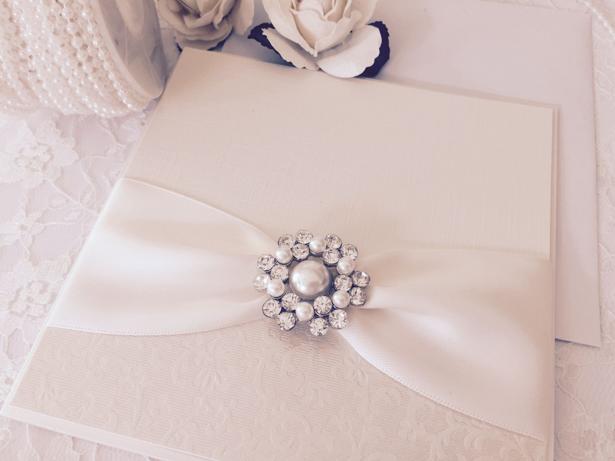 Elegant pearl brooch invitation in ivory