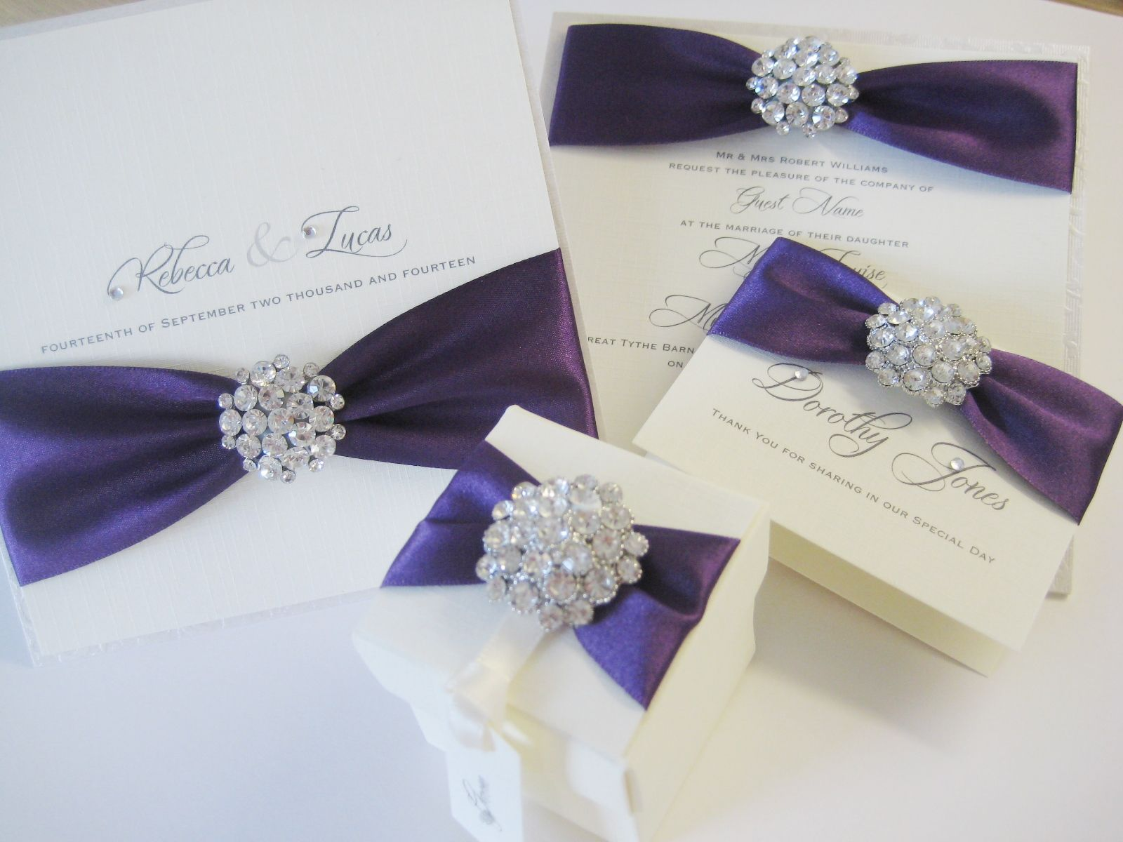 Sparkly diamante wedding stationery with cadburys purple ribbon