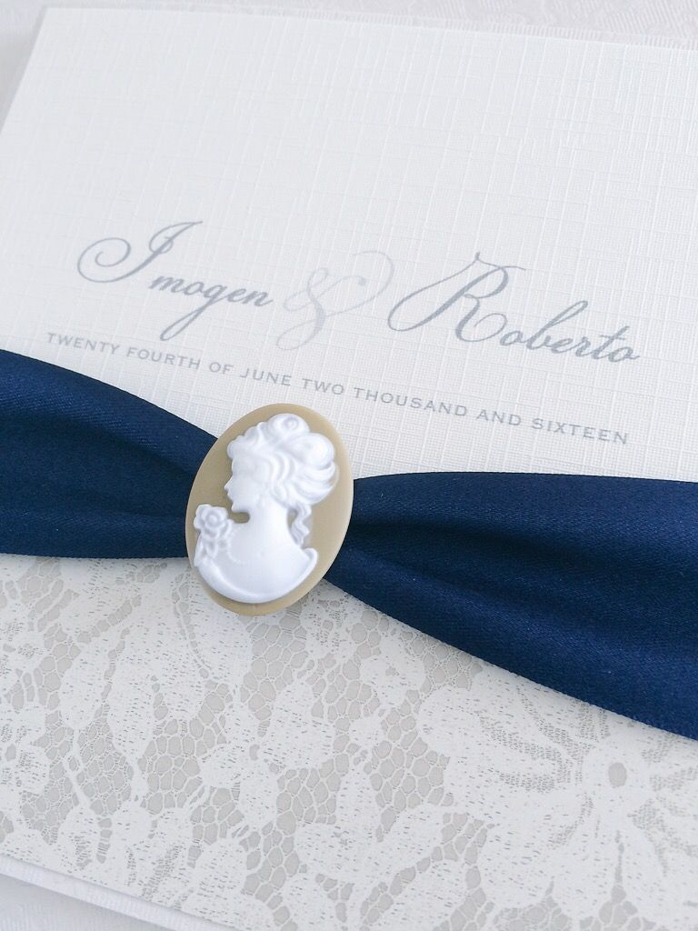cameo invitation with navy ribbon and brown lace detail