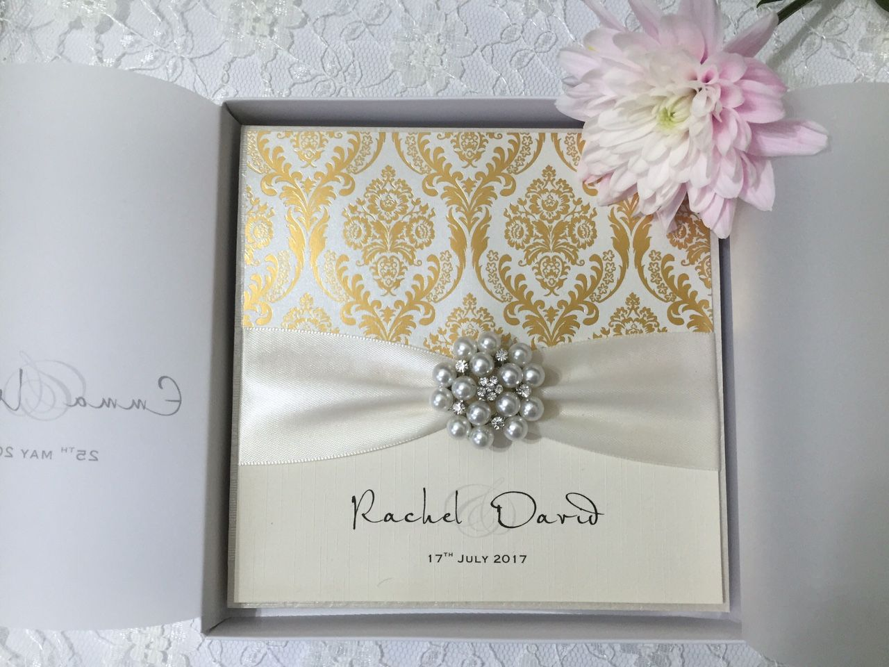 boxed gold and ivory invitation with pearl brooch