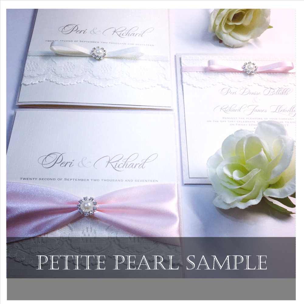 Simple wedding invitations with small pearl brooch