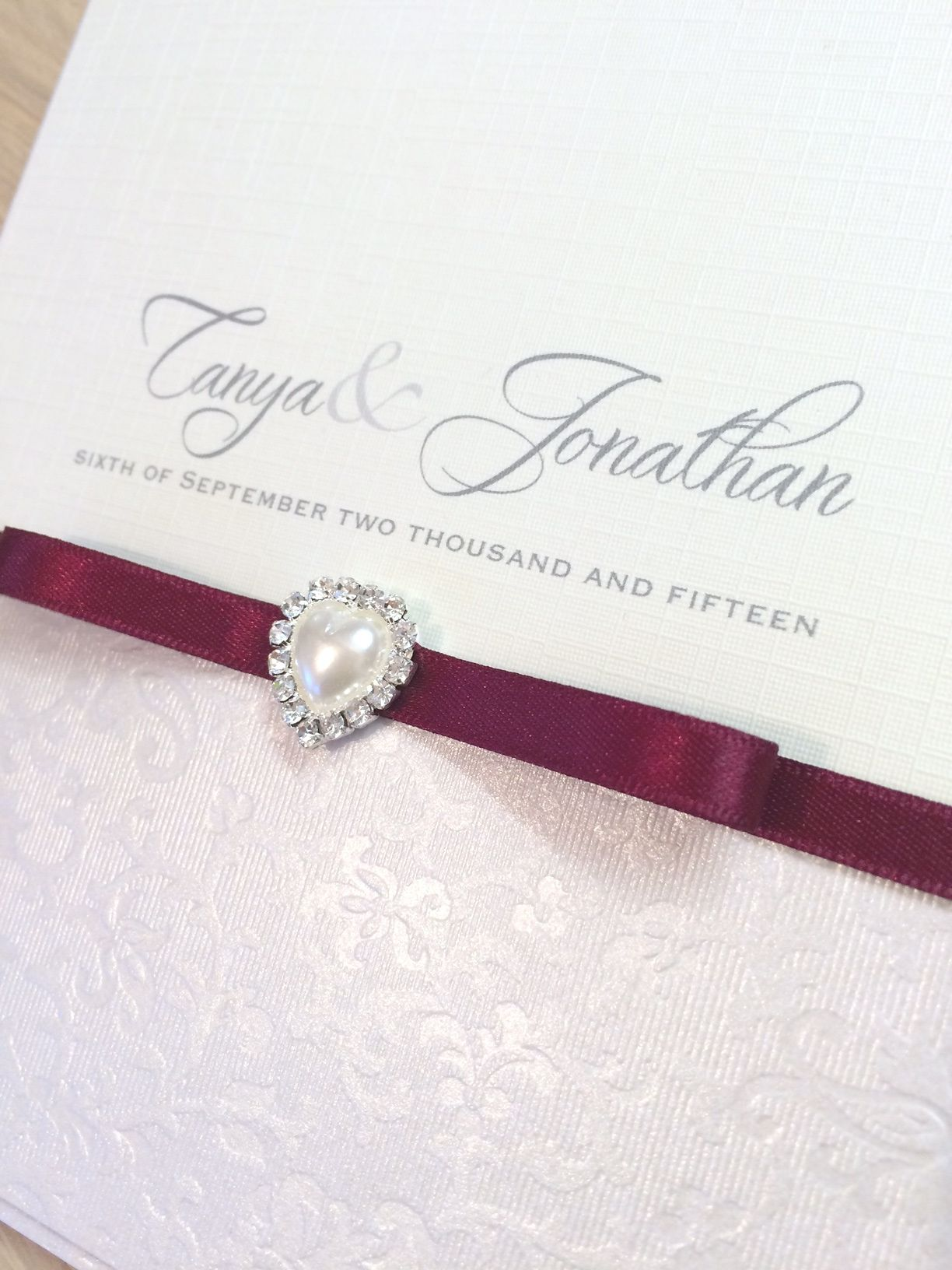 Invitation with small heart pearl and ribbon